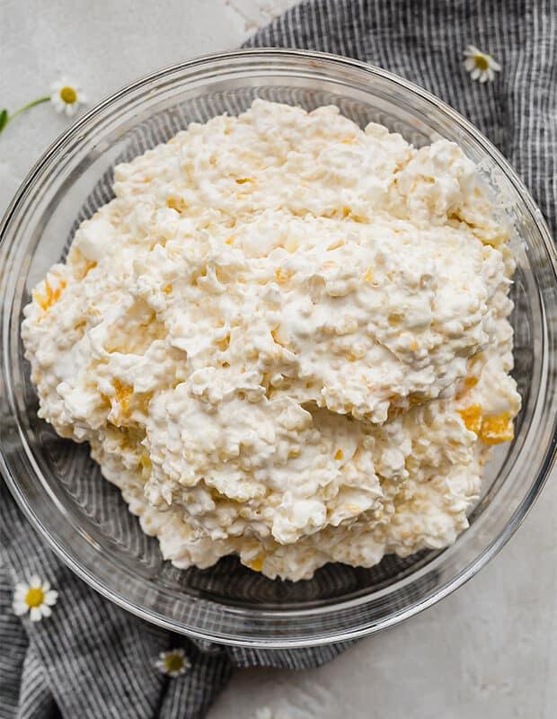 A bowl of acini de Pepe pasta with mini marshmallows.
