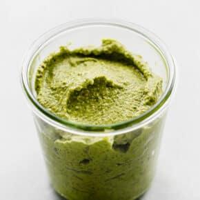 A jar of green sauce.