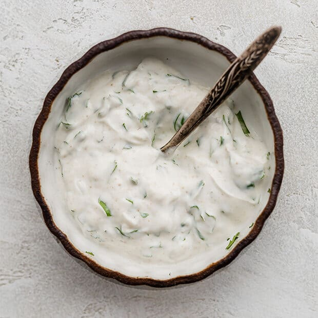 A bowl of cilantro lime greek yogurt dressing.