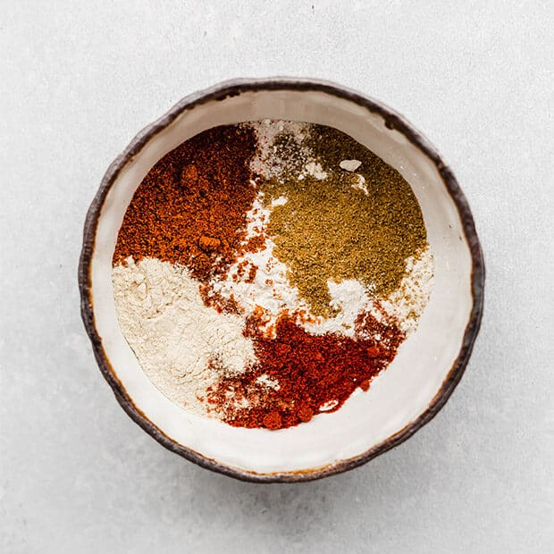 A bowl of seasonings to make Homemade Fajita Seasoning.