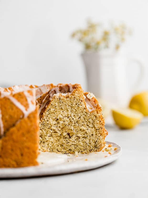 A Lemon Poppy Seed Bundt Cake sliced, showing the inside fo the moist cake.