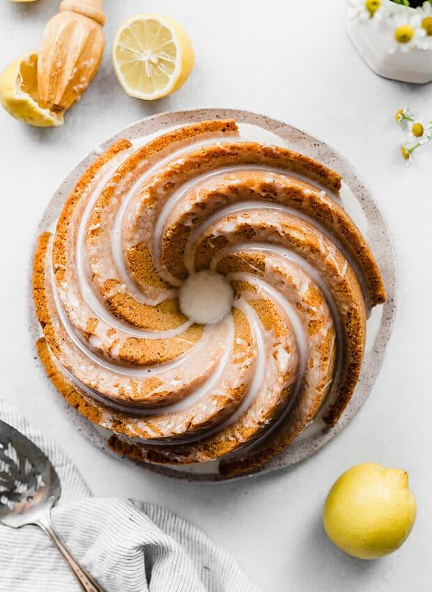 A Lemon glazed lemon Poppy Seed Bundt Cake on a plate.