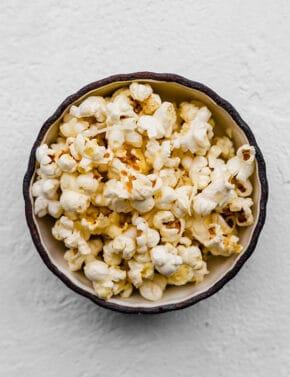 A bowl full of parmesan popcorn.