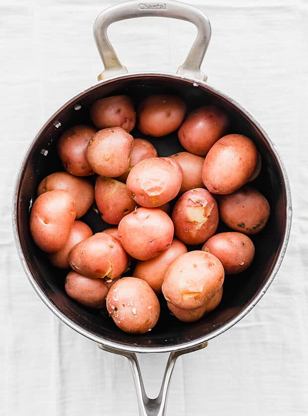Boiled red potatoes in a pot.