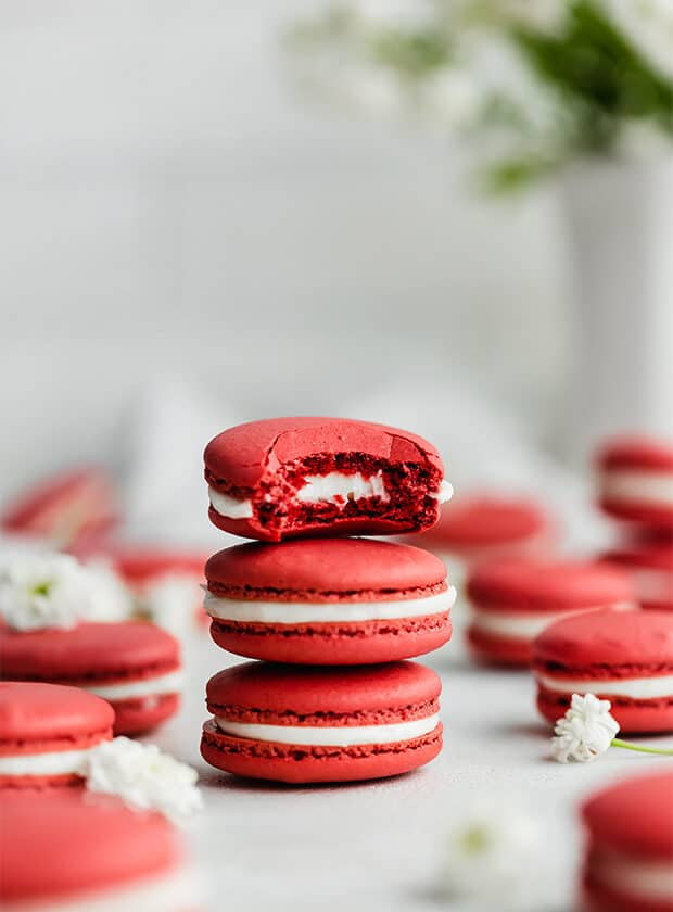 3 Red Velvet Macarons stacked on top of one another.