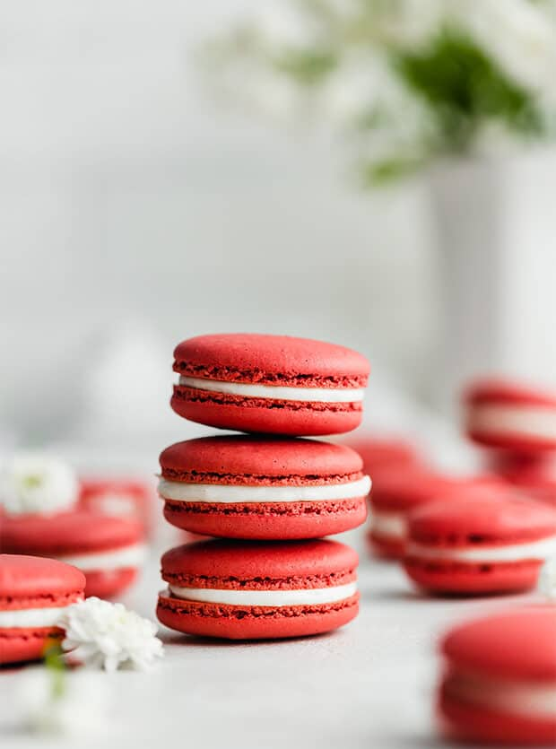 A stack of 3 Red Velvet Macarons against a white background.