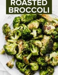 Plate full of roasted broccoli.