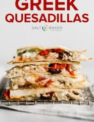 a stack of greek quesadillas cut into quarters.
