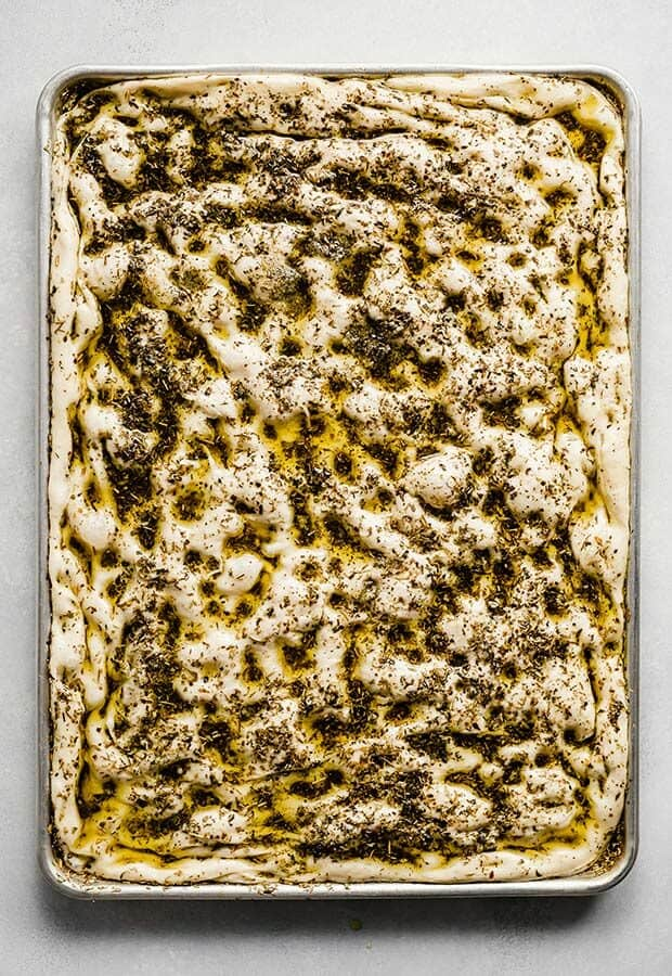Focaccia Bread dough covered in herbed olive oil.