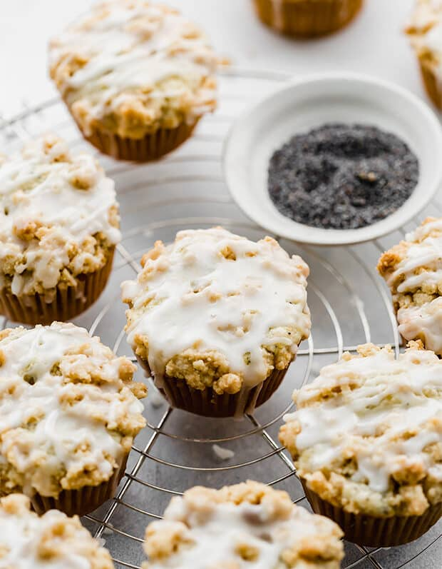 Lemon poppy seed muffins with a crumb topping and lemon glaze.