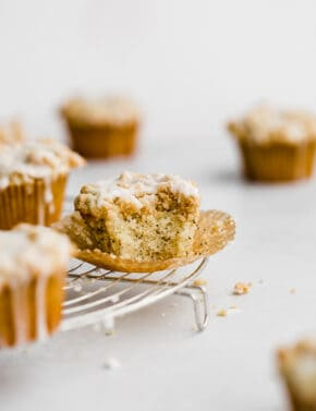 A Lemon Poppy Seed Muffin on a cooling rack.