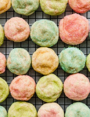 Sugar coated sugar cookies on a cooling rack.