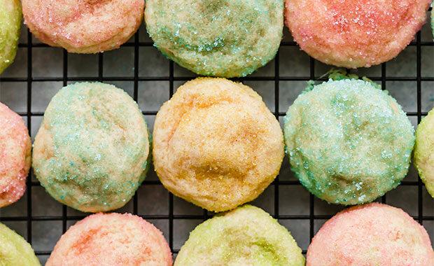 Sugar coated sugar cookies on a cooling rack.