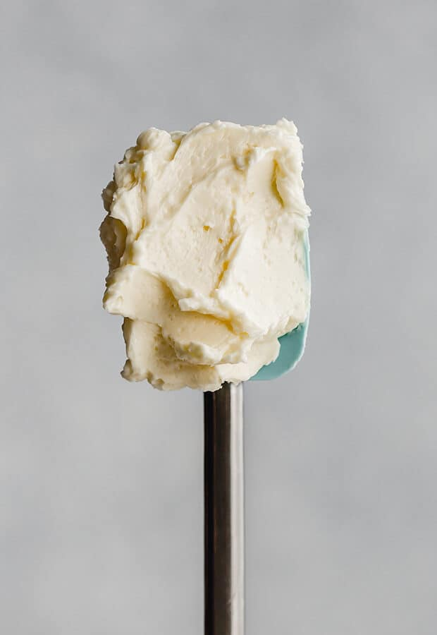 A spatula covered in Swiss meringue buttercream.