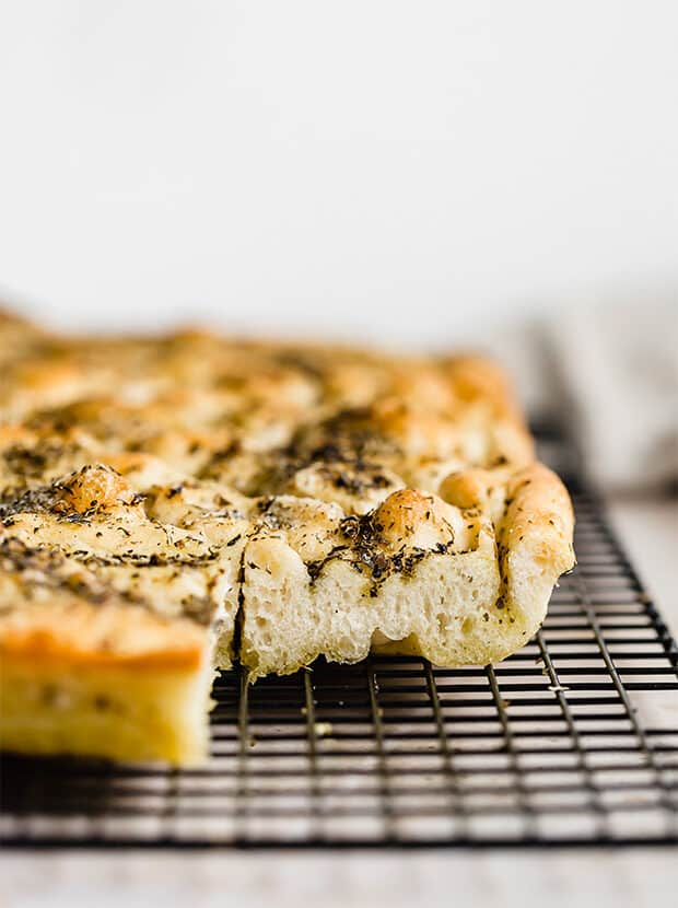 Fluffy Focaccia Bread on a black cooling rack.