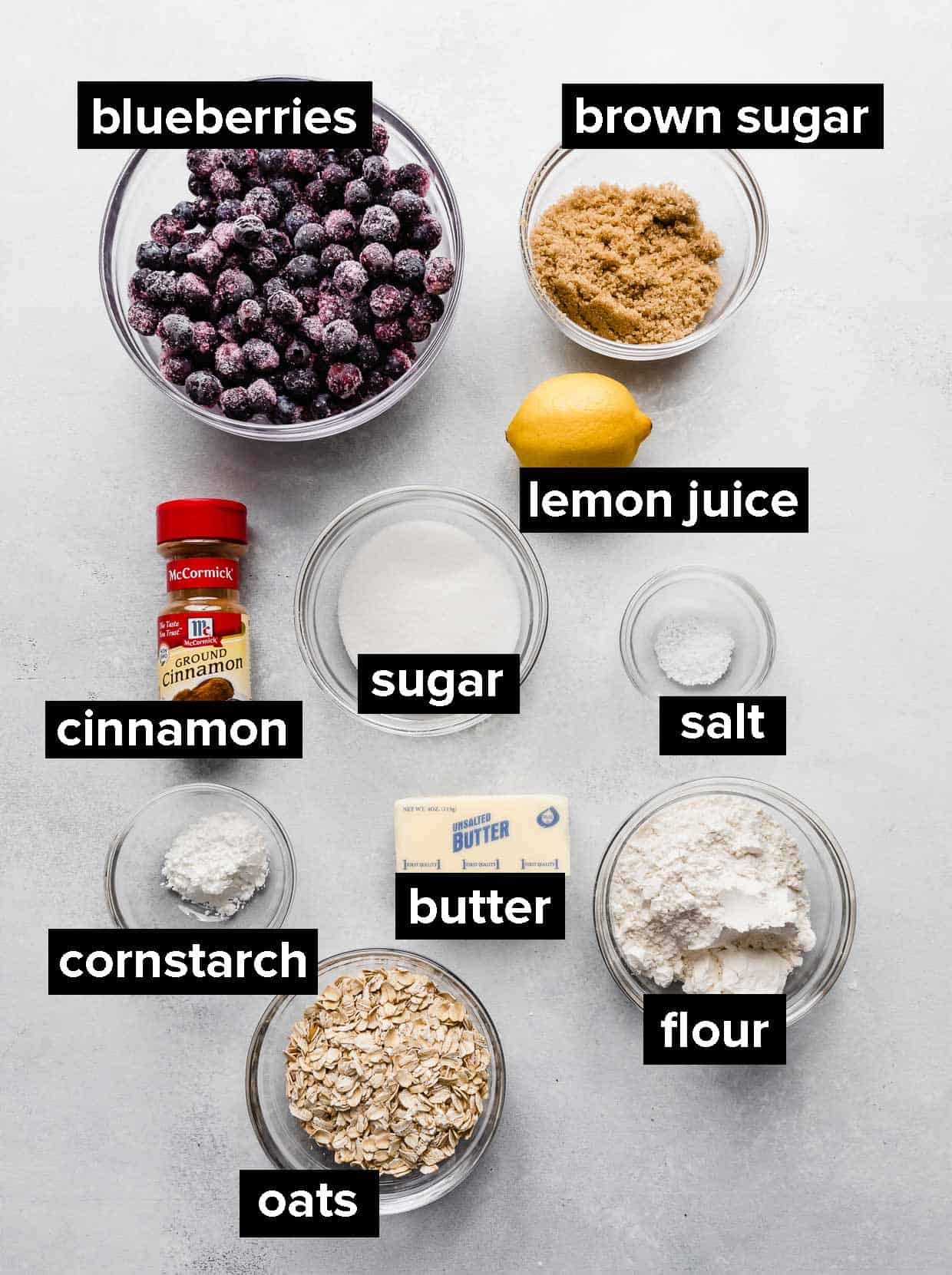 Blueberry crisp ingredients on a light colored background.