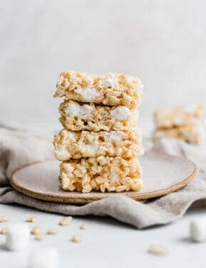 A stack of Rice Krispies Treats on a plate.