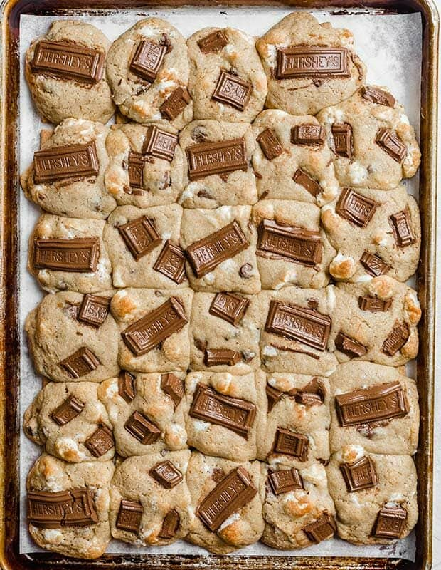 Fully baked marshmallow loaded cookie dough a top graham cracker squares.