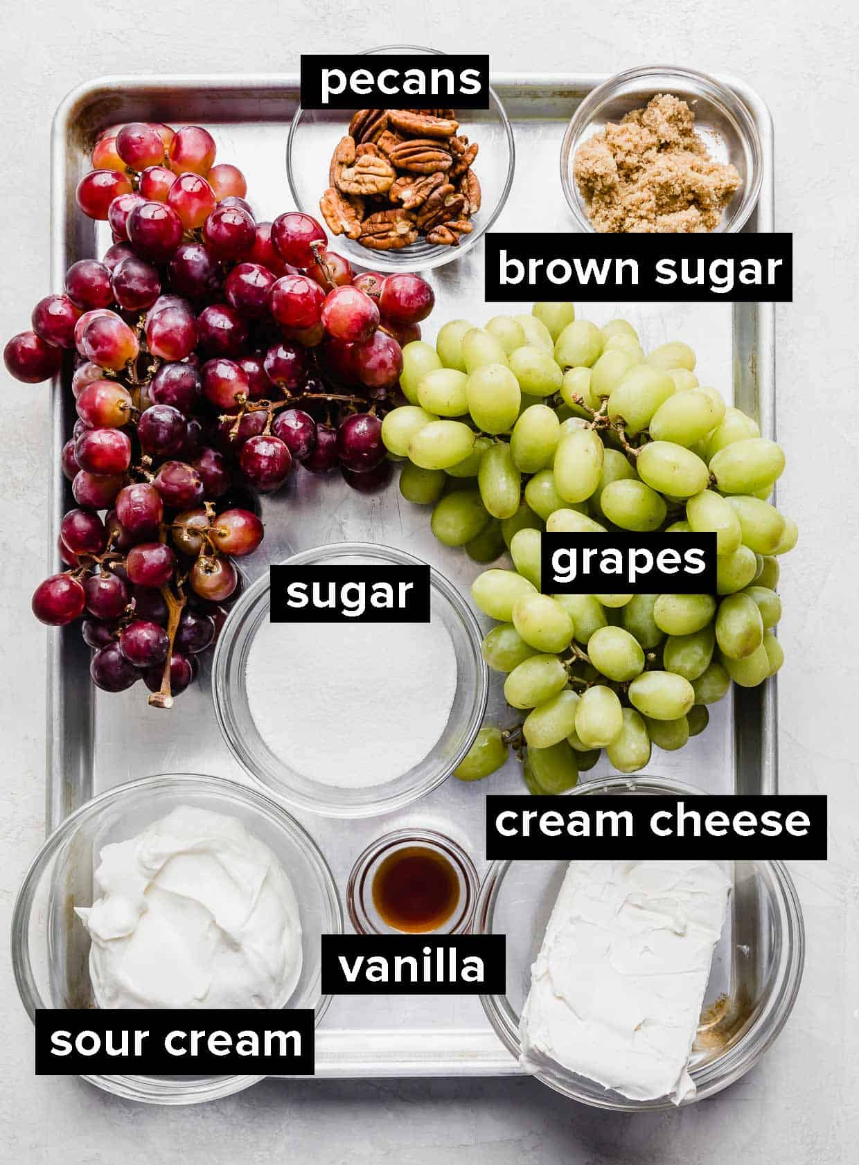 A photo of ingredients used to make creamy grape salad.