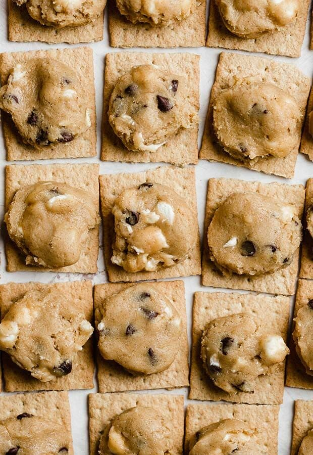 Graham cracker squares topped with a disk of marshmallow stuffed cookie dough.
