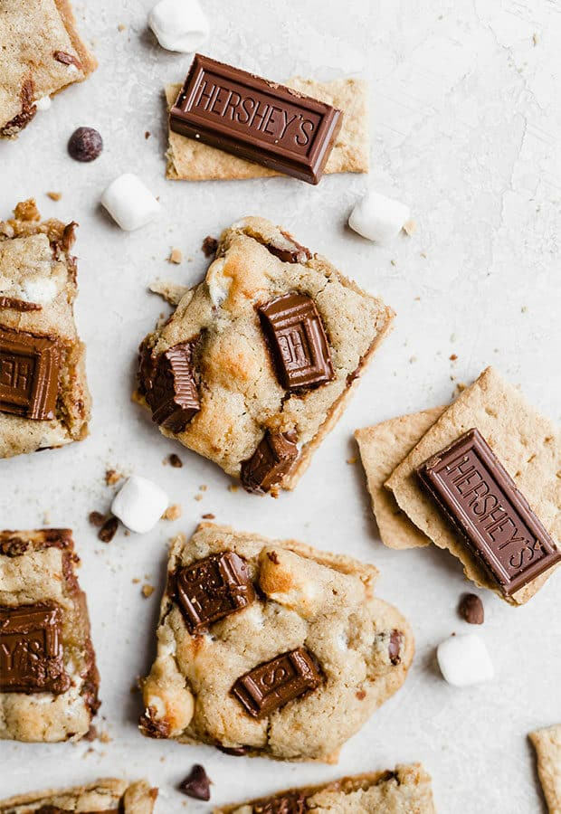 Overhead photo of a s'mores cookie topped with pieces of a Hershey's chocolate bar.