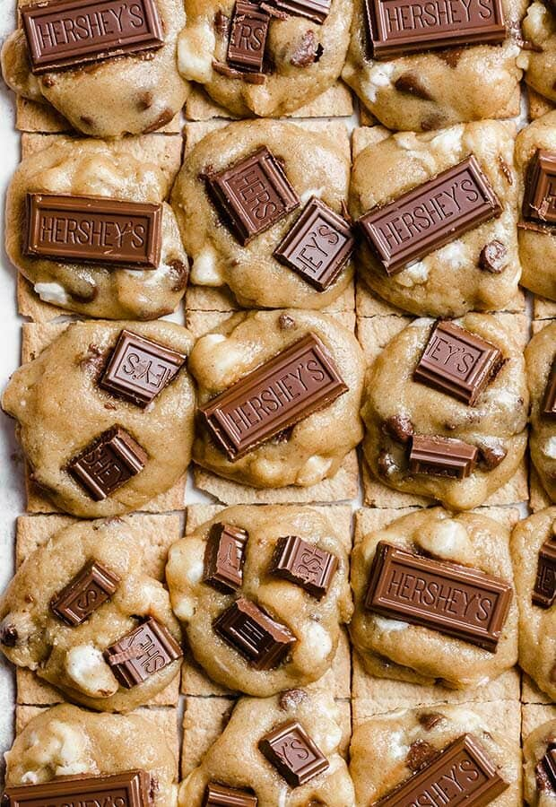 Close up photo of cookie dough disks topped with Hershey's chocolate bar pieces.