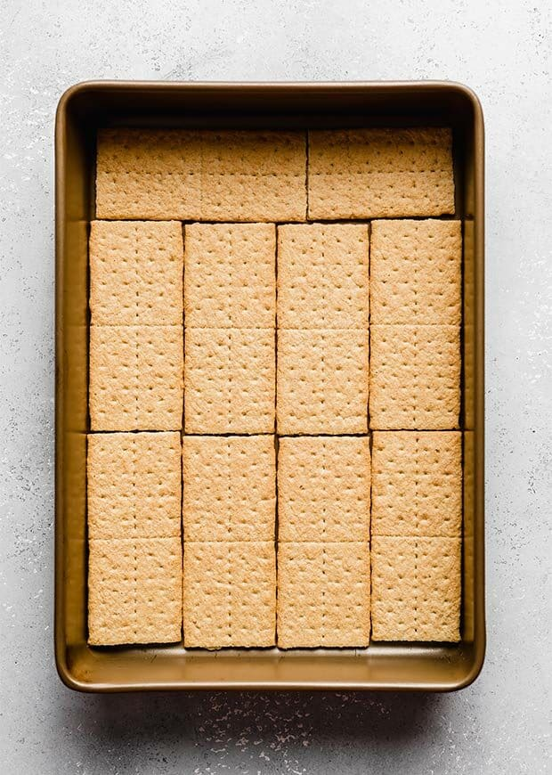 Overhead photo of a 9x13 inch pan lined with graham crackers.
