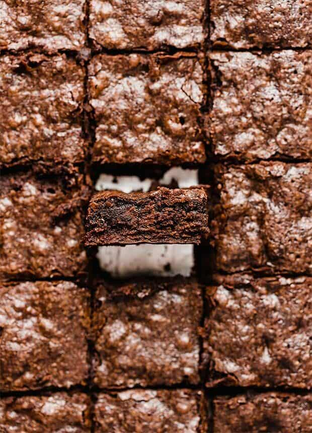Brownies cut into squares, lined up side by side.