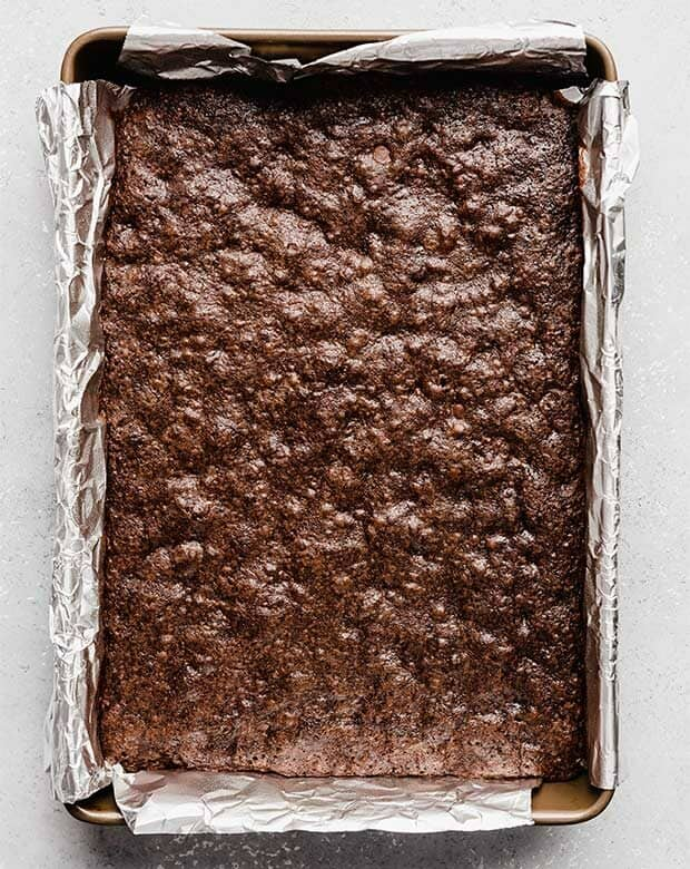 A 13 x 9 inch pan of baked homemade brownies.