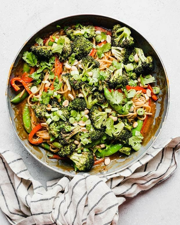 Overhead photo of a skillet full of Peanut Noodles and veggies.
