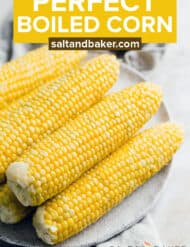 Boiled corn on the cob on a white plate.