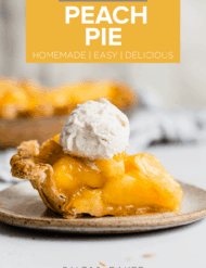 A slice of fresh peach pie on a plate with a small scoop of vanilla ice cream on top.