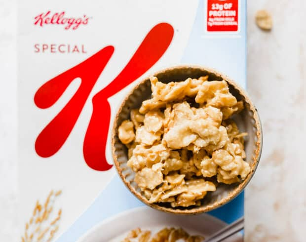 A bowl of Special K Cereal Candy sitting on top of a box of Special K Cereal.