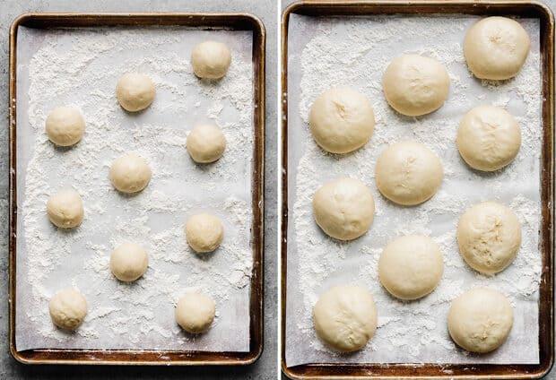 Balls of doughnut dough spread out over a baking sheet.