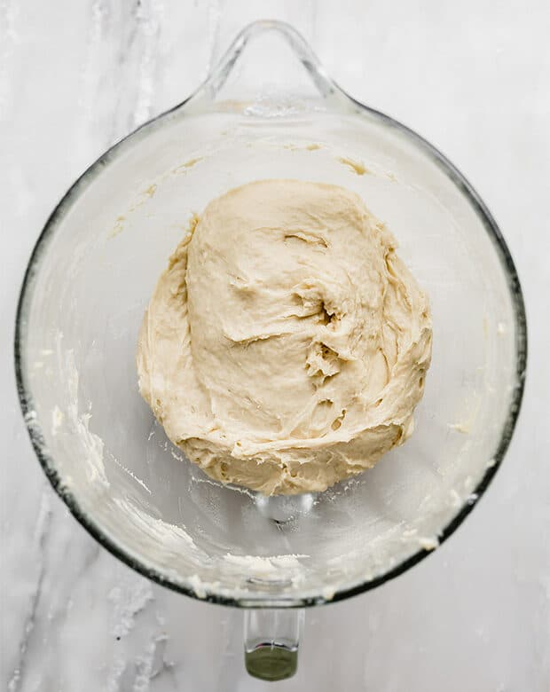 Doughnut dough in a glass bowl prior to rising and doubling in size.