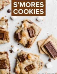 A square s'mores cookie topped with chocolate bar bits.
