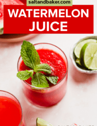 A glass of watermelon juice on a light pink background.