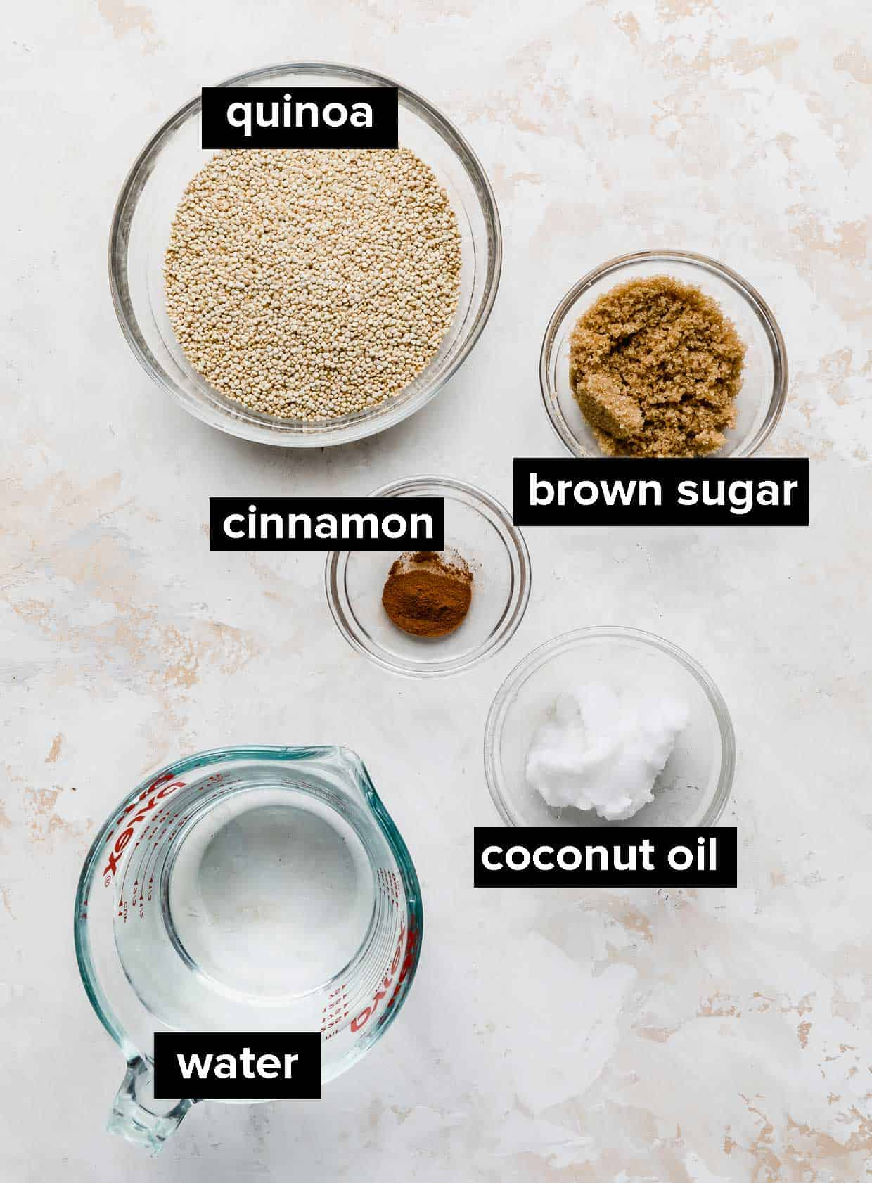 Ingredients used to make breakfast quinoa on a white background.