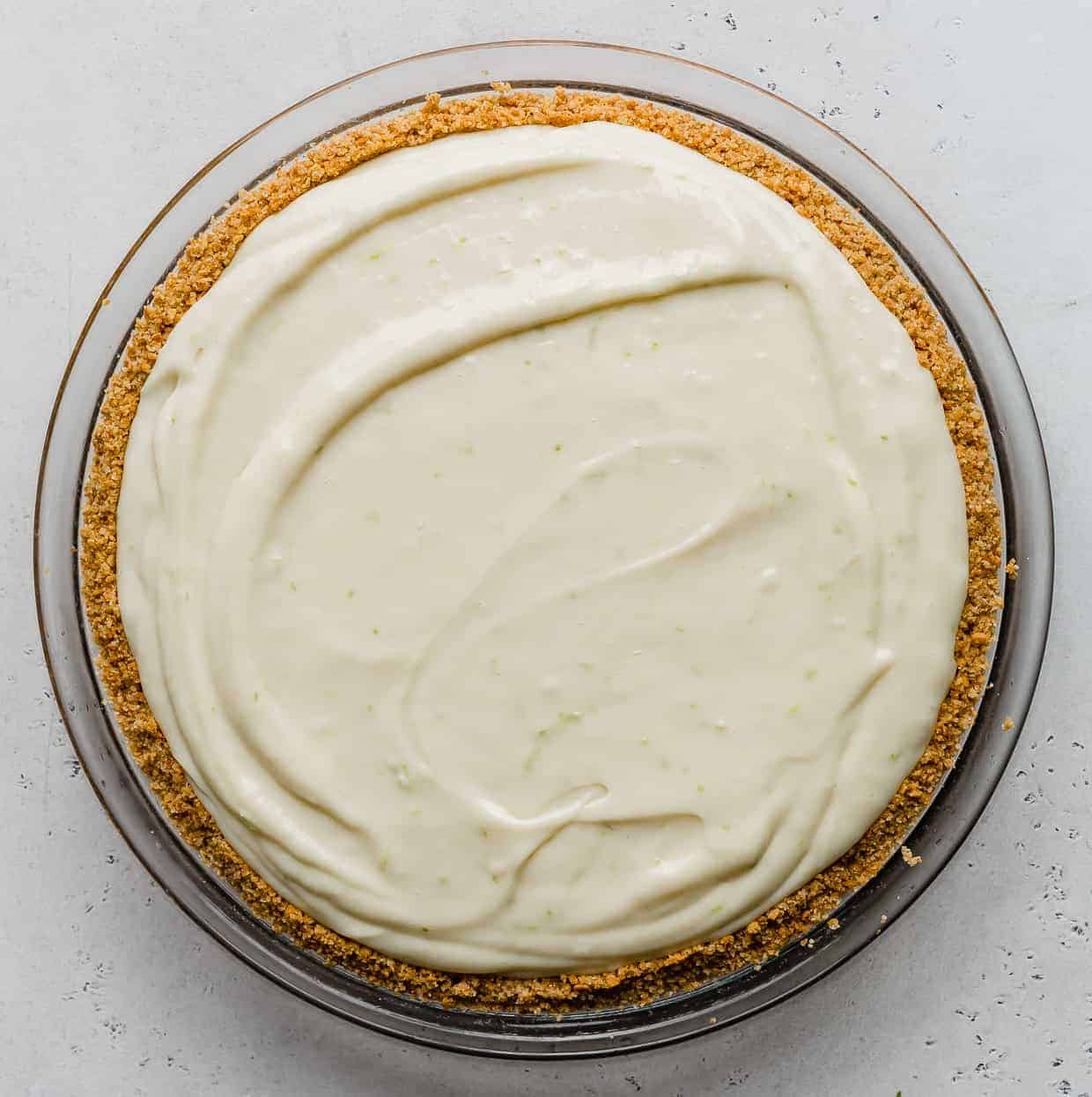 Key lime pie filling in a graham cracker crust.