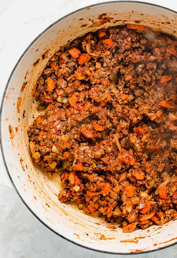 Ground sausage, onion, carrots, and celery in a large pot.