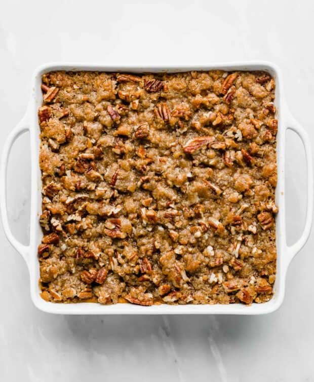 Pecan crumble topping on top of a sweet potato mashed mixture.