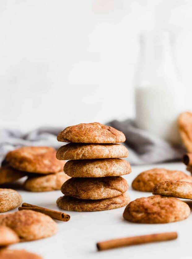 A stack of snickerdoodle cookies against a white background.