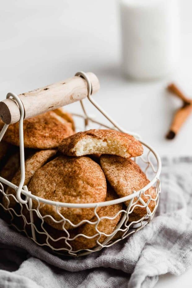 Snickerdoodle cookies in a wire basket.