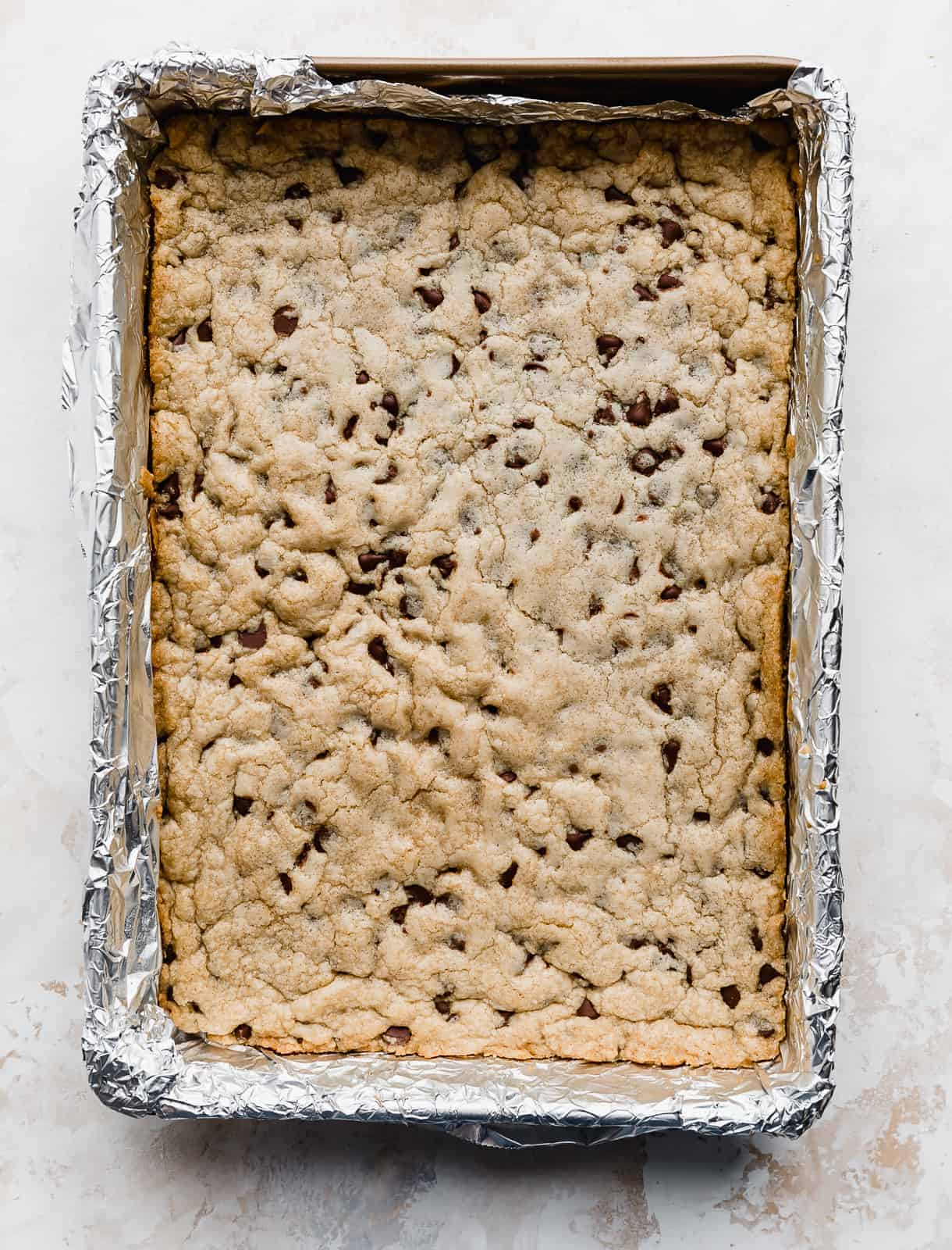 Chocolate Chip Cookie Bars in a foil lined 9x13 inch pan.