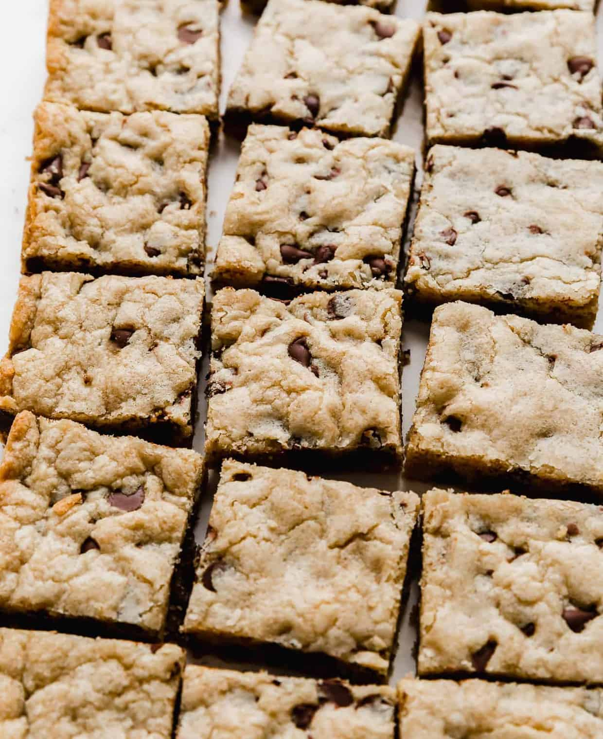 A side angle of Chocolate Chip Cookie Bars cut into squares.
