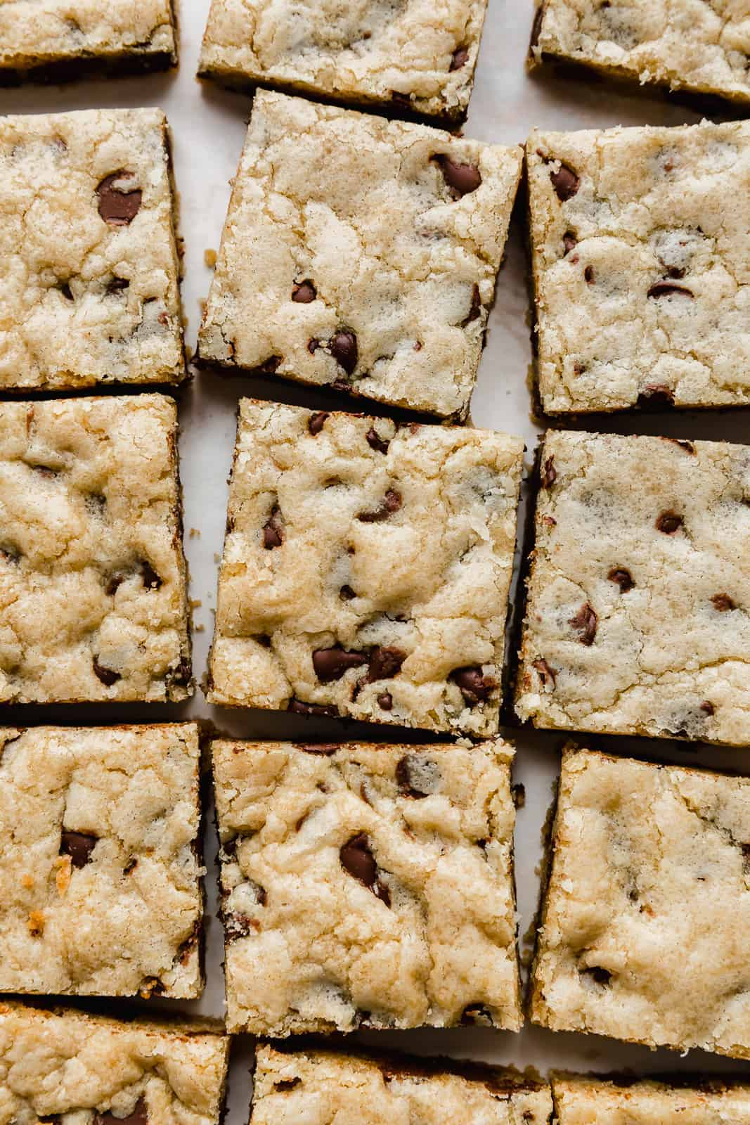 A close up of Chocolate Chip Cookie Bars cut into squares.