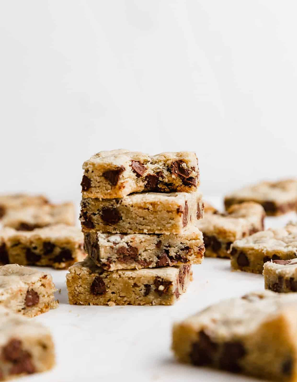 A stack of 4 Chocolate Chip Cookie Bars against a white background.