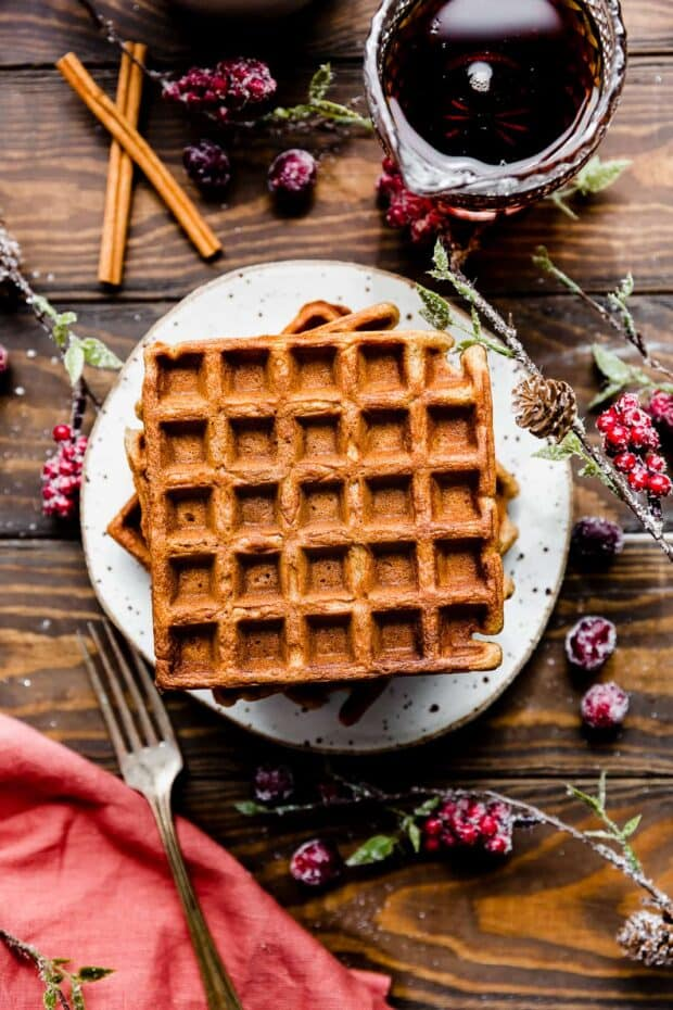square Gingerbread Waffles on a wooden background.