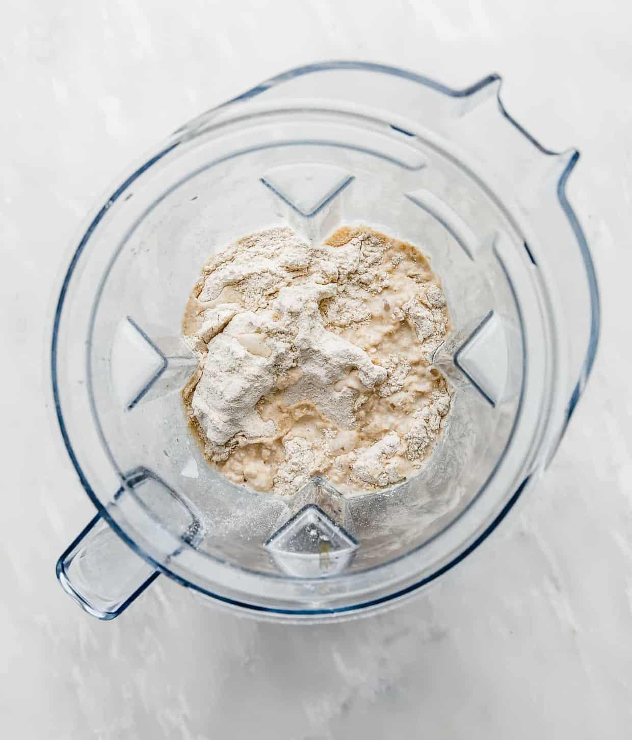 A blender full of ingredients used to make healthy German pancakes.