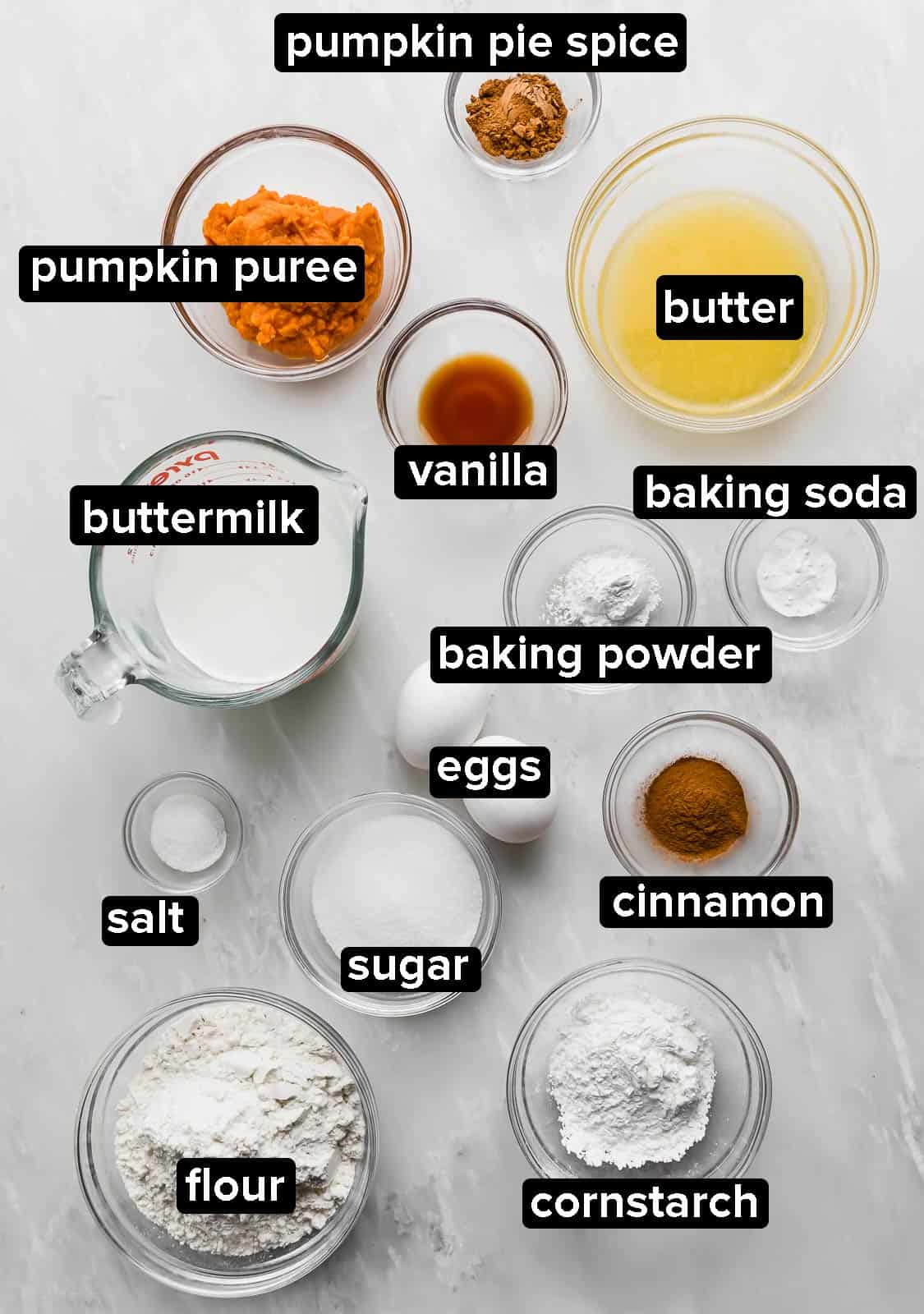 Ingredients used to make pumpkin waffles on a white background.